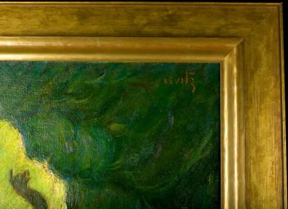 The artist's signature and frame corner profile upper right