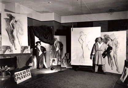 "Publicity photo of the artist Rolf Armstrong creating ""Carmen"""