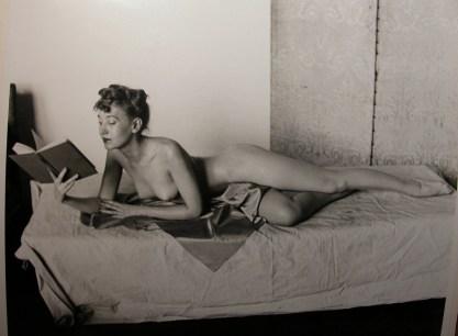The artist Zoe Mozert reading in bed...