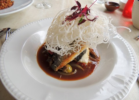 ALQUIMIA: Fillet of sea bream in a chicken and vegetable sauce with peppers, aubergine, onion and olives topped with crispy noodles (£18.80