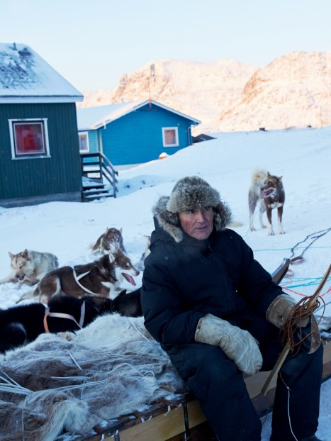 Dog sled master in Greenland by Axel Sig