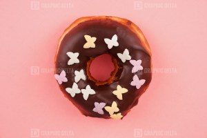Donut with butterfly sprinkles stock image