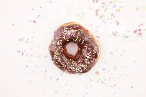 Donut with colorful sprinkles background