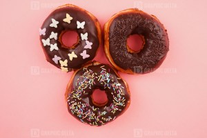 Homemade donuts on pink background