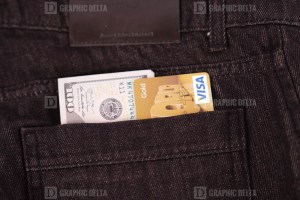 Visa and dollars in jeans pocket