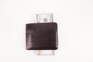 Wallet full of dollars stock image