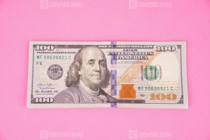 American Hundred Dollars Isolated on Pink