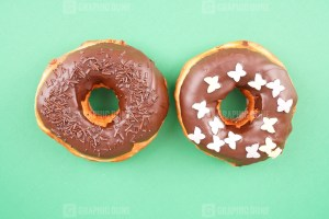 Donuts on green background