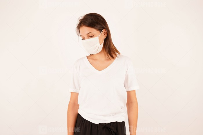 Sad woman wearing protective mask