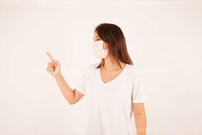 Girl in mask pointing finger away