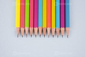 Set of pencils on bright blue