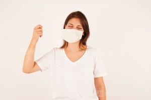 Young woman wearing the coronavirus mask