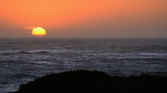 The day ends as the ocean swallows the Sun.