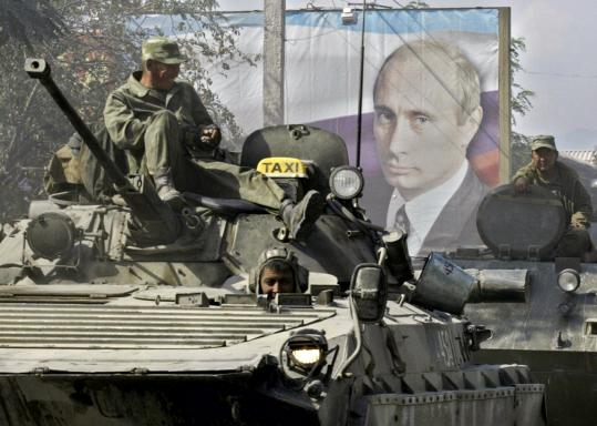 Russian troops take up position in South Ossetia in August, note Putin propaganda already in place.
