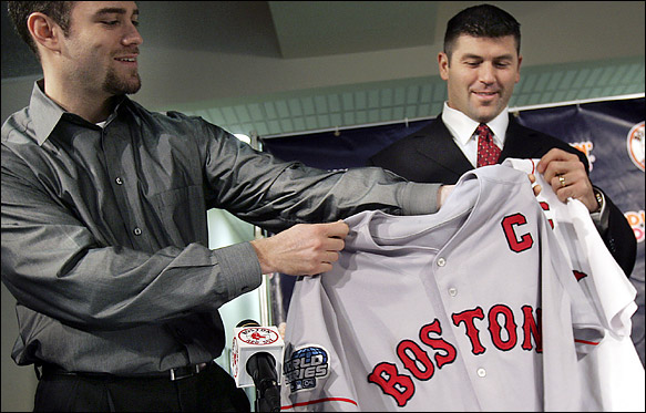 General Manager Theo Epstein of the Red Sox, left, introducing catcher Jason Varitek as the team's captain.