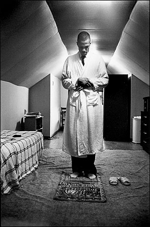 Malcolm X Making Salat (Muslim Prayer) circa 1963