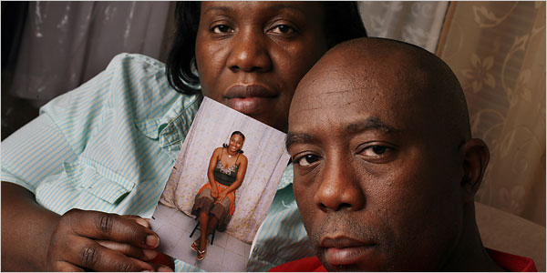 Sandra and Balfour Francis of Brooklyn, with a photograph of Nickiesha, who is in Jamaica. Last year, DNA tests showed she is not his daughter.