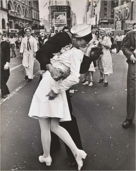 An unnamed U.S. sailor boldly celebrates Japans surrender with an unnamed, passing nurse, in Times Square, New York, August 15, 1945 - Alfred Eisenstadt, Life Magazine