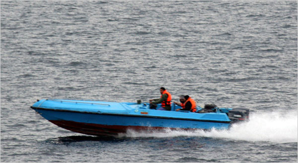 The United States Navy released this photograph of a speedboat suspected of being from Iran's Revolutionary Guard Navy maneuvering near three Navy warships on Sunday in the Strait of Hormuz. The United States has said five armed Iranian speedboats confronted the warships. (US Navy via Getty Images)
