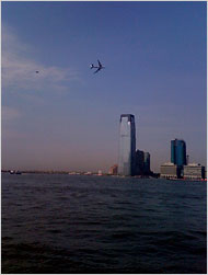Photo by New York Times reader Dan Kohn, of two Air Force jets conducting low-level maneuvers over Manhattan