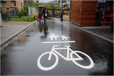 Bike/ped street in Vauban, Germany (New York Times, Martin Specht), click for full slideshow