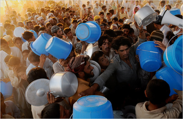 After months of Taliban cruelties and broken promises, Pakistanis anger at the Taliban now seems to outweigh their frustration with the military campaign that has crushed many of their houses and killed their relatives. But there is growing concern about the three million refugees displaced by the fighting.  Displaced Pakistanis lined up for dinner rations.