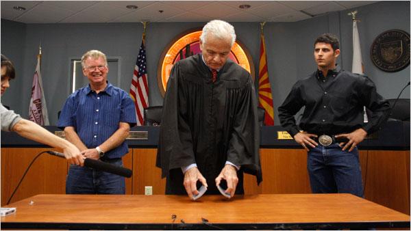 L to R: Thomas McGuire, Judge George Preston, Adam Trenk. [New York Times]