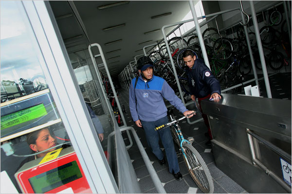 The terminal stations of TransMilenio routes are equipped with huge bicycle parking facilities. An extensive network of bicycle paths and sidewalks were built leading to the stations. Free green feeder buses also circulate through the outskirts of Bogotá to shuttle residents to TransMilenio stations. By drawing in passengers who would have otherwise driven private cars or taken small polluting buses, the system has improved traffic flow and reduced emissions. - NYT