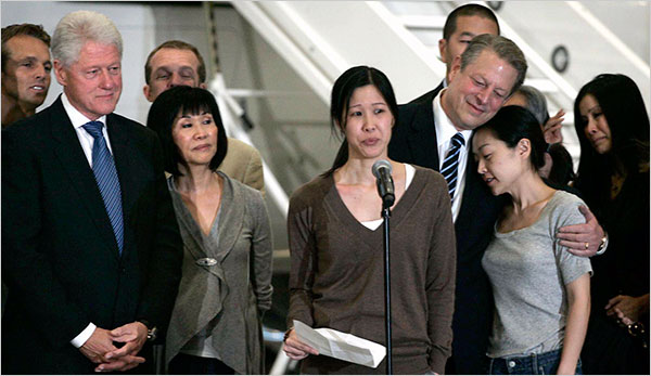 Laura Ling spoke to the news media as former Vice President Al Gore embraced Euna Lee after they arrived in Burbank, Calif. on Wednesday. Mr. Gore founded the company that employs the journalists.
