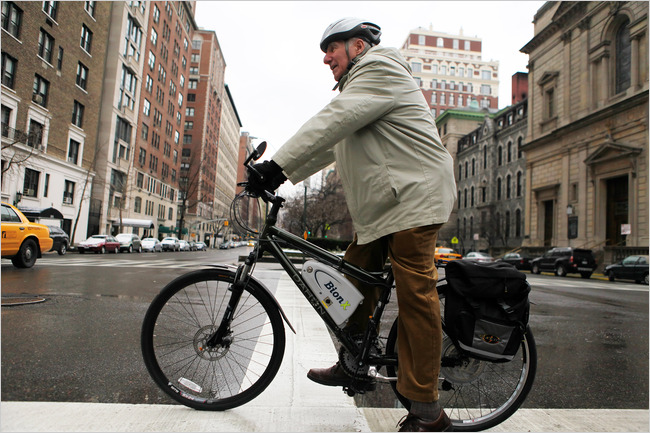 78 year old man on a bike with an electrically powered rear wheel.