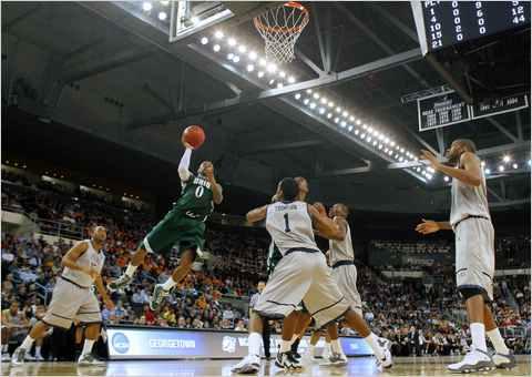 Ohio University's Armon Bassett goes to the hoop against Georgetown.