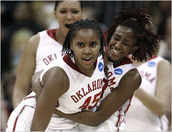 Oklahoma guard Jasmine Hartman, #45, was congratulated by guard Danielle Robinson after a play during the second half against Kentucky.