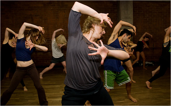 This New York Times images shows choreographer Mandy Moore with students.