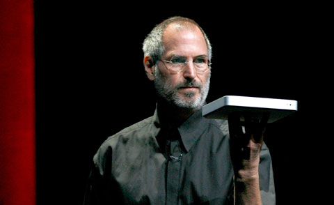 Steven P. Jobs holding the Apple TV