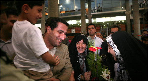The Iranian scientist Shahram Amiri, with his 7-year-old son, greeting  family members in Tehran.Newsha Tavakolian/Polaris, for The New York Times