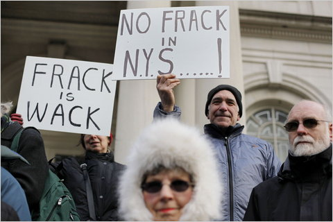 People protesting plans for hydraulic fracturing in January on the steps of City Hall in New York City.