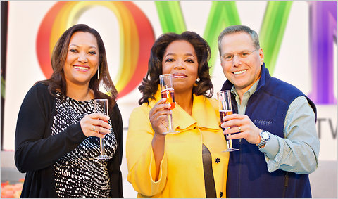 About 770,000 people tuned in on New Year's Day for the inaugural hour of OWN, which Discovery expects to be profitable within its first year. Above, Oprah Winfrey with Christina Norman, C.E.O. of OWN, and David Zaslav, president and C.E.O of Discovery Communications.