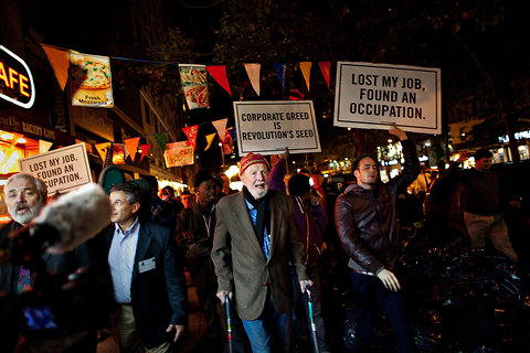 Pete Seeger, with canes, joined the Occupy Wall Street protests on Friday night. The 92-year-old marched all the way from 95th Street to Columbus Circle.