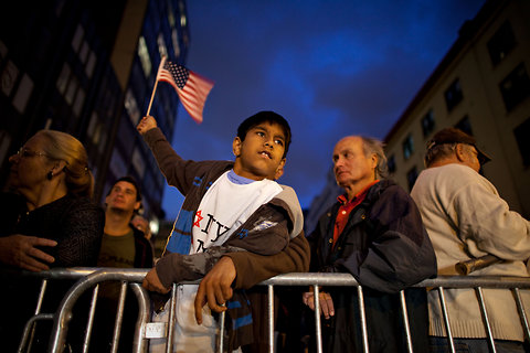 Ali Merali, 9, raised the American flag at a candlelight vigil on Murray and Church street, near the proposed Park 51 mosque, in New York, N.Y., on Sept. 10, 2010.