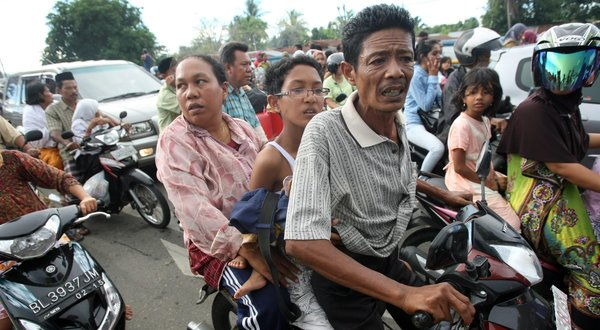 Indonesians escaping possible quake induced Tsunami