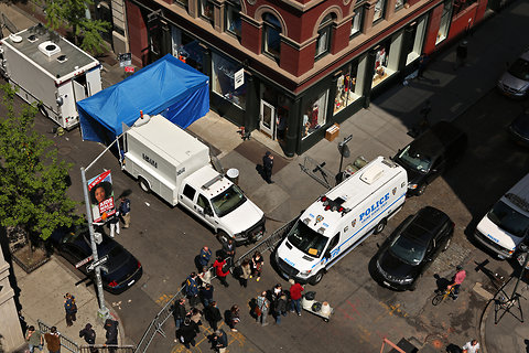 Investigators and their vehicles massed in front of a building at Prince and Wooster Streets in SoHo Thursday morning in their search for traces of Etan Patz in the basement.