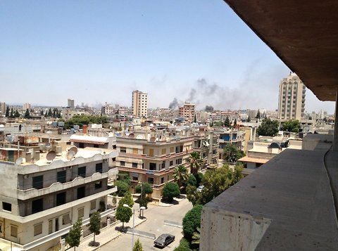 An image posted to Twitter by the BBC's Paul Danahar showed smoke over Homs on Monday.