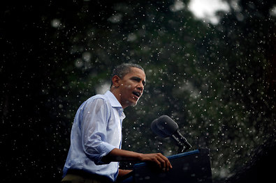President Barack Obama delivers remarks in the rain at a campaign event at Walkerton Tavern & Gardens in Glen Allen, Va., on Saturday.