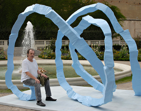 """Franz West with one of his his sculptures titled """"Ergebnis"""", 2008"""