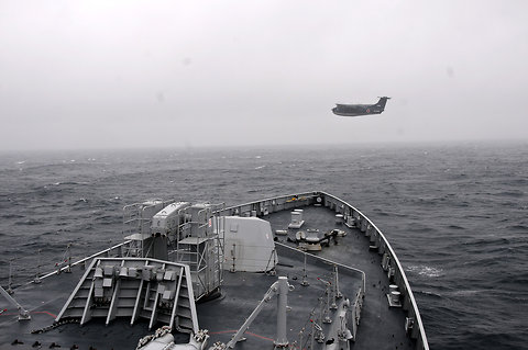 An Indian naval ship and a Japanese Maritime Self-Defence Force seaplane, during a naval exercise between India and Japan held off the coast of Tokyo, Japan in June 2012.