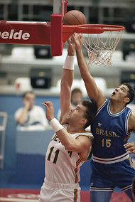 Arvydas Sabonis, left, battling for the ball with Brazil's Israel Machado in an Olympic quarterfinal game in 1992.