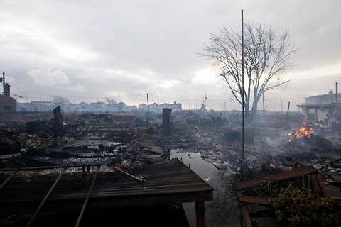 Damage caused by a fire at Breezy Point is shown on Tuesday.