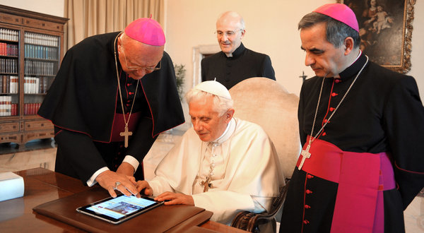 Pope Benedict XVI using an iPad at the Vatican last year. His first Twitter post is expected on Dec. 12.