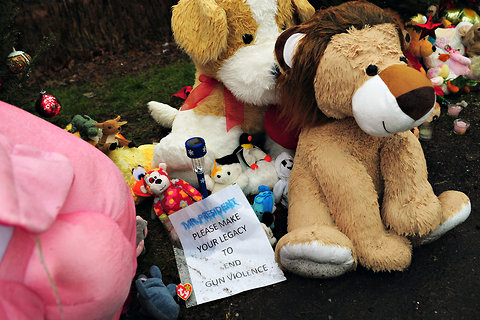 A message addressed to President Barack Obama was among the stuffed toys at a makeshift shrine to the victims of the elementary school shooting in Newtown, Conn., on Monday.