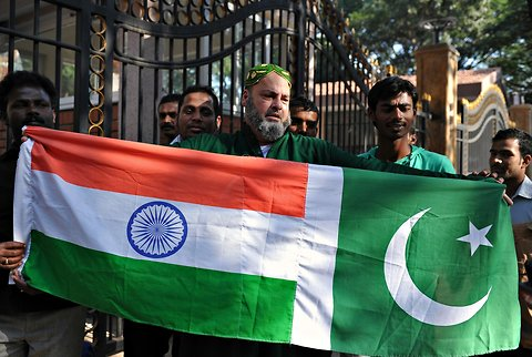 Cricket fans holding the flags of India, left, and Pakistan, in Bangalore, Karnataka, on the eve of a five-match cricket series between India and Pakistan.